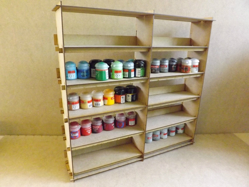 I did find a few different solutions though and a few ideas on how to build my own. Of the ones actually made for this purpose this one is a good choice & Building a citadel paint rack or shelf - Jester Painting Studio